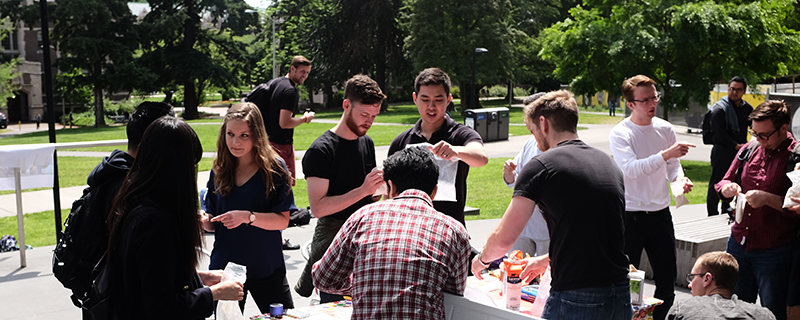 Students taking part in campus supply chain outdoor activity